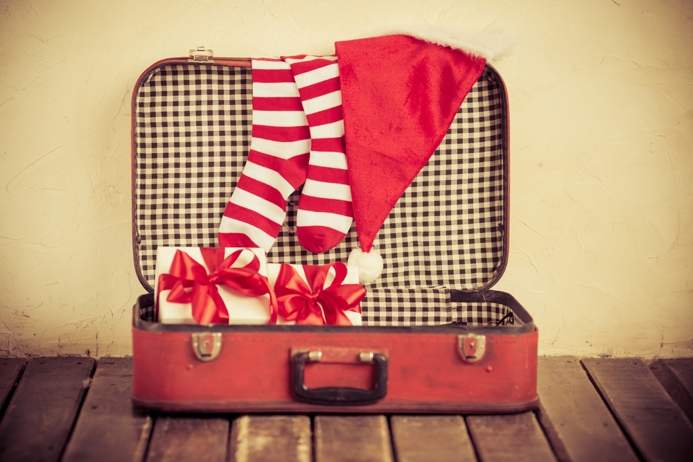 Christmas decorations in suitcase