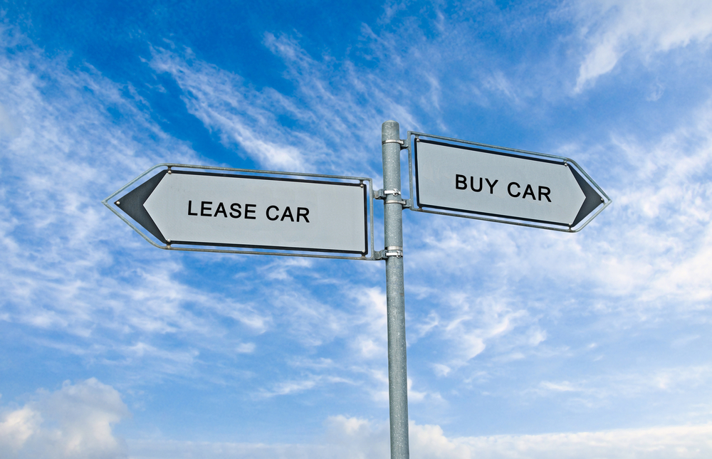 Road sign to lease and buy car