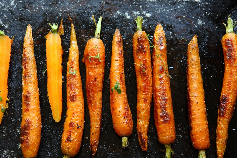 baked carrots on a baking sheet, food close up