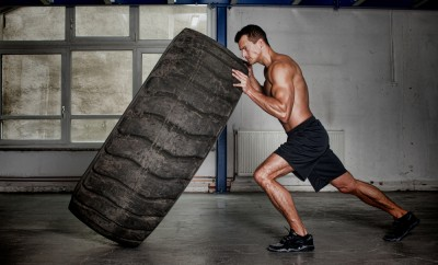 best workout supplements man flipping tire