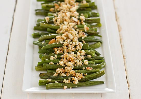 green beans with lemon almond pesto on white table