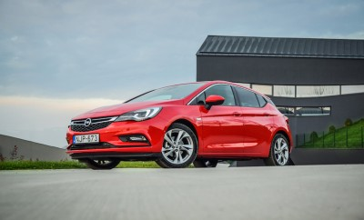 2016 model year Opel Astra (generation K) at the test-drive. Red hatchback Opel Astra is equipped with headlights that consist of 16 individual matrix LED