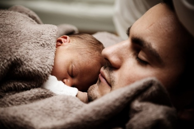 attractive man dad holding infant baby