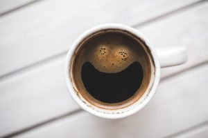 coffee in white mug with smiley face