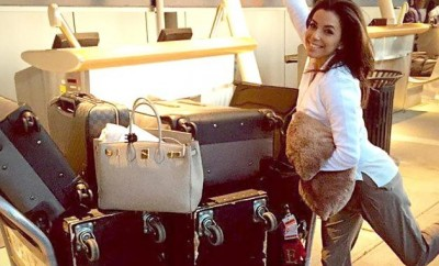 happy woman with a lot of travel luggage