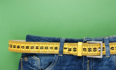 jeans with meter belt slimming on the green background