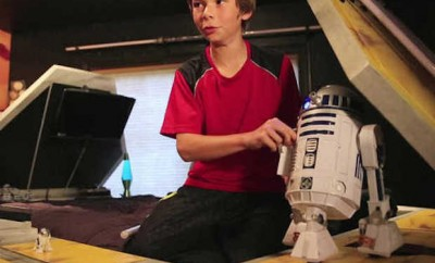 kid with r2d2 robot