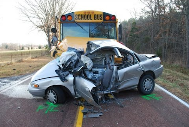 silver car hit by yellow school bus