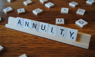 Annuity spelled in scrabble tiles