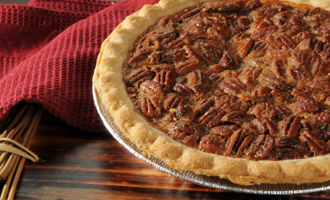 Close Up shot of a Pecan Pie Cooling on a Chopping Block