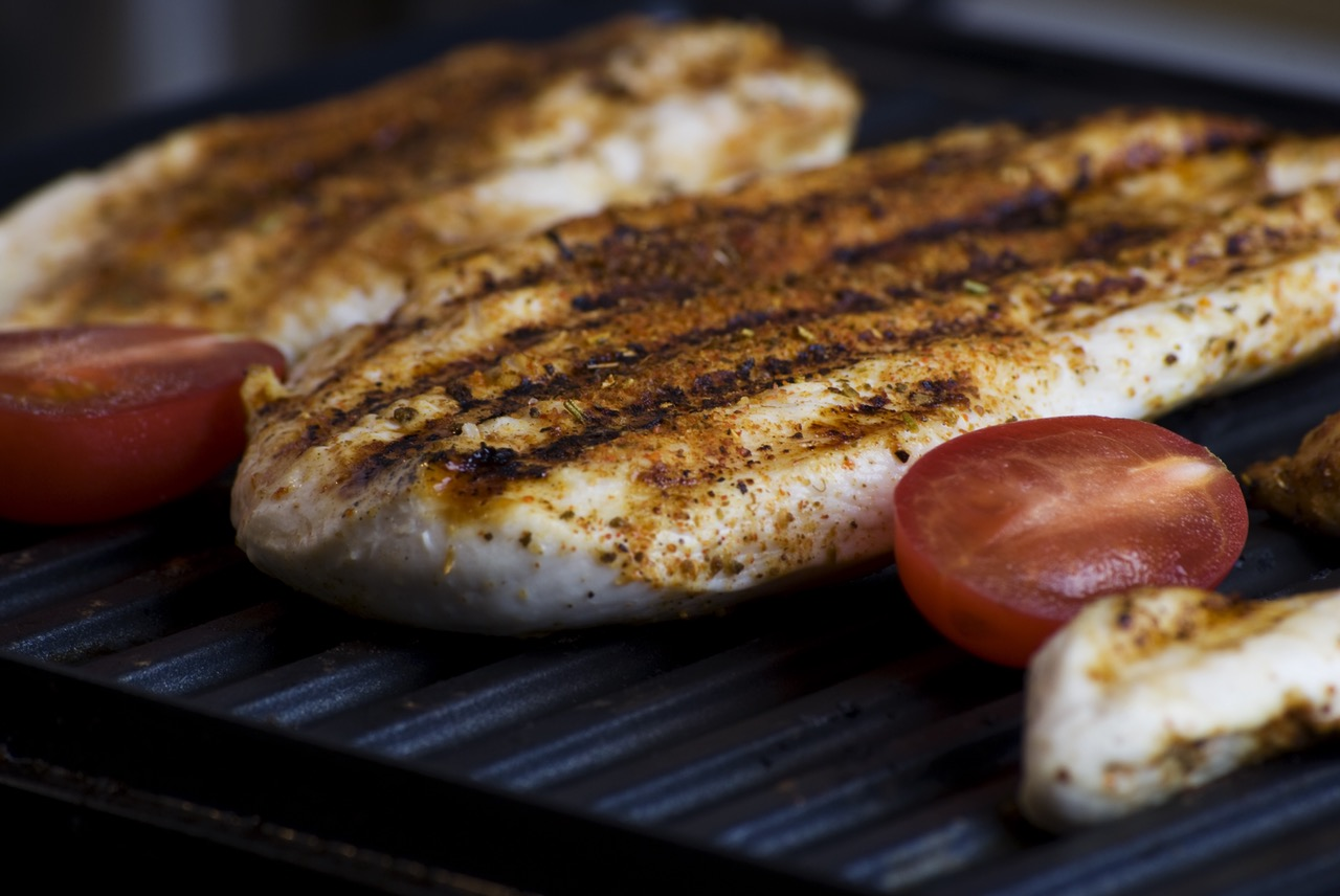 chicken breasts and cherry tomatoes on grill grilling