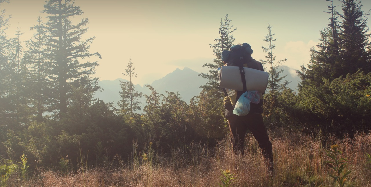 man backpacking on mountain in colorado wild