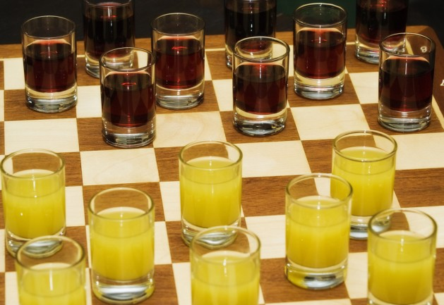 Chess set Glasses with juice on a chessboard