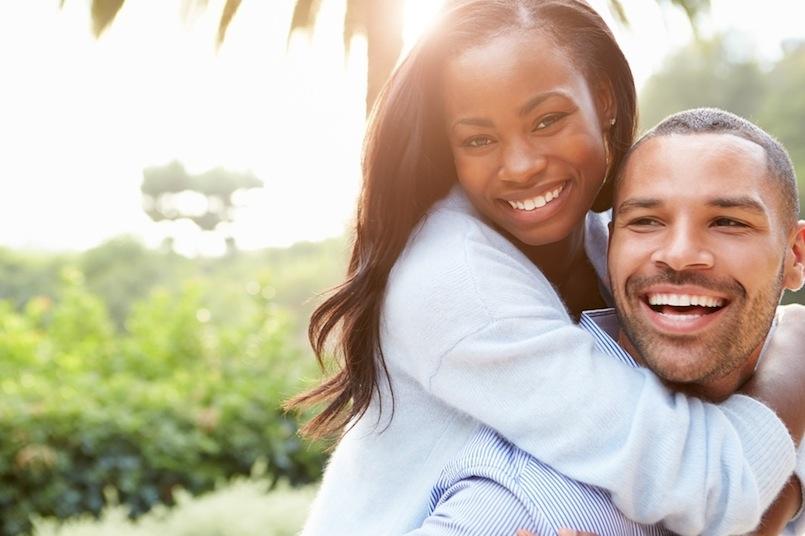 black couple embracing outside