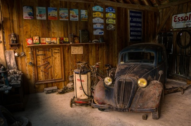 old rusty car in dark garage