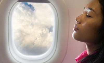 woman sleeping at air plane