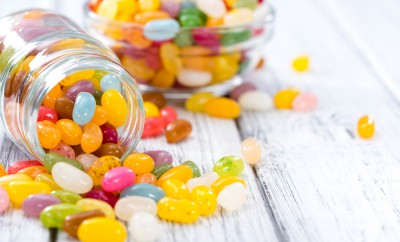 Colorfull Jelly Beans (close-up shot) on bright wooden background
