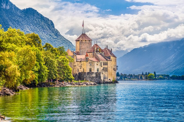 Beautiful view of famous Chateau de Chillon at Lake Geneva, one of Switzerland's major tourist attractions and most visited castles in Europe, with blue sky and clouds, Canton of Vaud, Switzerland