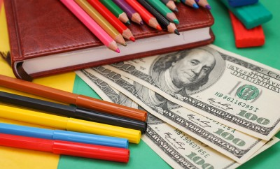 Pens, colored pencils, plasticine, book, hundred dollar bills