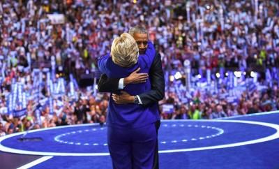 President Barack Obama embraces Democratic nominee for president Hillary Clinton