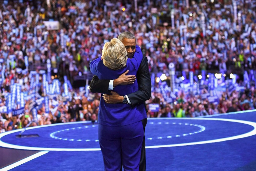 President Barack Obama embraces Democratic nominee for president Hillary Clinton