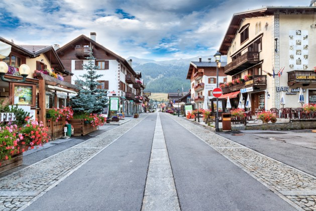 Street Lined with Quaint Buildings in Tourist Destination Village of Livigno, Italy in Valley of Italian Alps