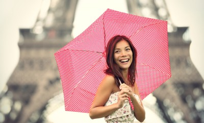 Paris Eiffel Tower Woman happy smiling in front of tourist attraction Eiffel Tower. Joyful fresh Caucasian Asian girl laughing