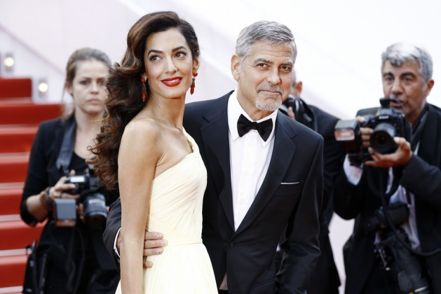 Actor George Clooney and his wife Amal Alamuddin Clooney attend the 'Money Monster' premiere during the 69th Cannes Film Festival