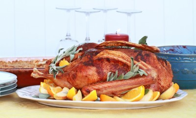 Baked Christmas goose with fresh oranges, apples and sage. Served with cranberry sauce and sweet potato souffle
