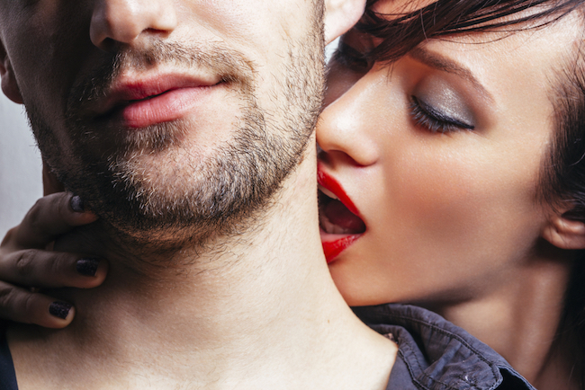 Woman kissing a man on the neck