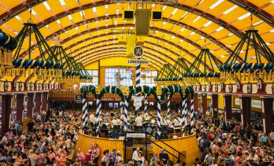 Munich, Germany- October 2, 2014: People drinking in the Lowenbrau Beer Tent on the Theresienwiese Oktoberfest fair grounds
