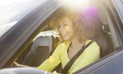 Mixed race girl driving a car