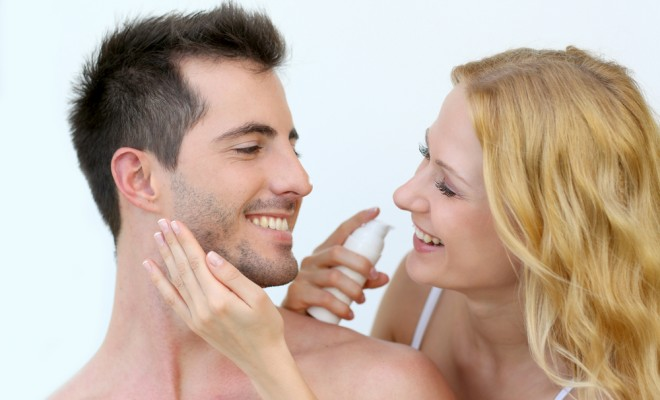 woman-applying-sunscreen-on-her-boyfriends-cheeks