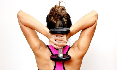 woman in gym exercises weight lifting