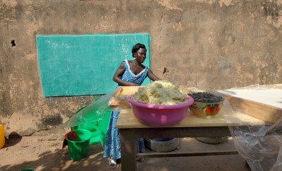 An African woman produces shea butter