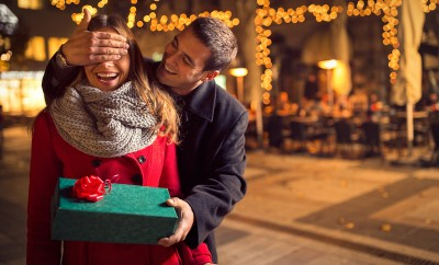 man-keeps-his-girlfriend-eyes-covered-while-she-giving-a-gift-romantic-surprise-for-christmas