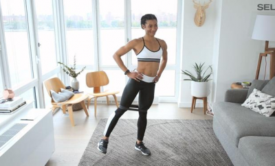 fit woman doing workout fitness in living room of home in workout clothes