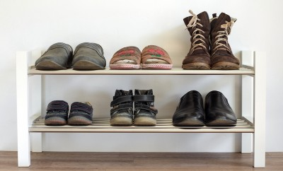 six-pairs-of-shoes-on-a-shelf-in-the-hallway-in-the-house-for-the-whole-family-dads-mamas-and-child