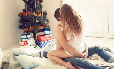 oung-sweet-pretty-couple-in-love-kissing-in-christmas-eve-near-tree-with-gifts-at-home-in-december