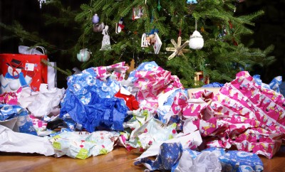 a-mess-of-wrinkled-wrapping-paper-scattered-under-the-christmas-tree