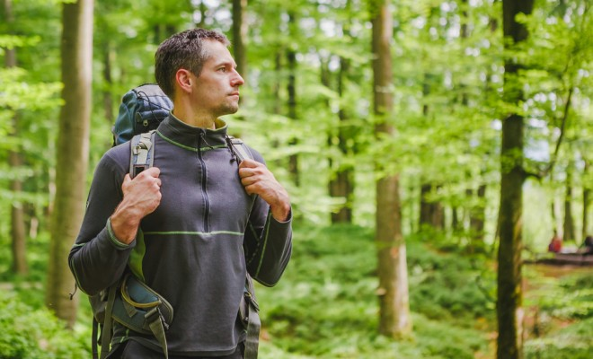 active-healthy-man-hiking-in-beautiful-forest