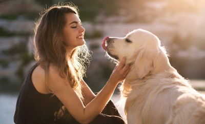 beauty-woman-with-her-dog-playing-outdoors