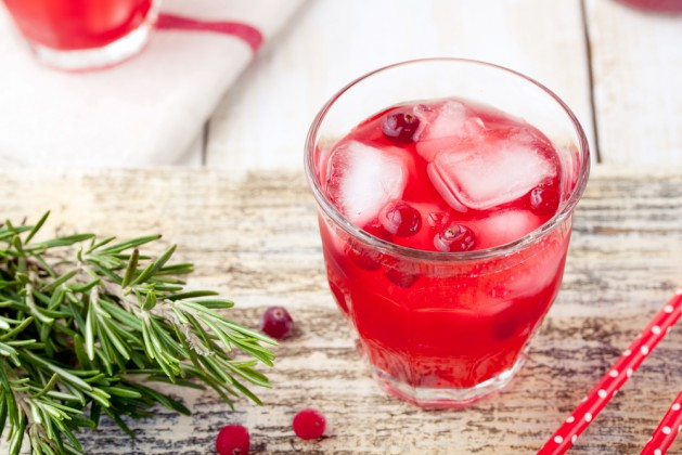 Cranberry and rosemary lemonade, cocktail, fizz on a white wooden background