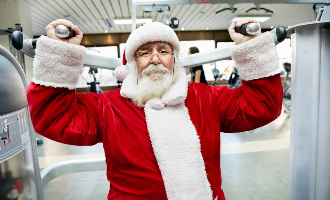 santa-claus-doing-exercise-on-machine-at-gym