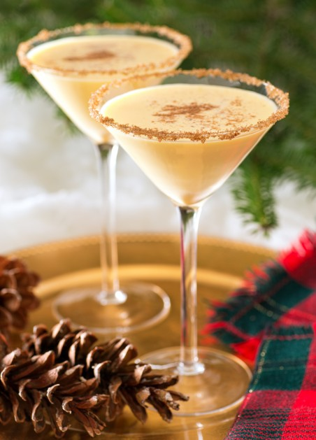 Two delicious eggnog martinis with brown sugar rimmer and cinnamon sprinkle