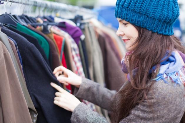 woman-choosing-clothes-at-flea-market