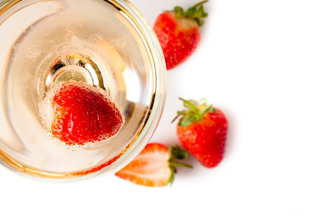 cold champagne with strawberries on a white background, isolated, close-up
