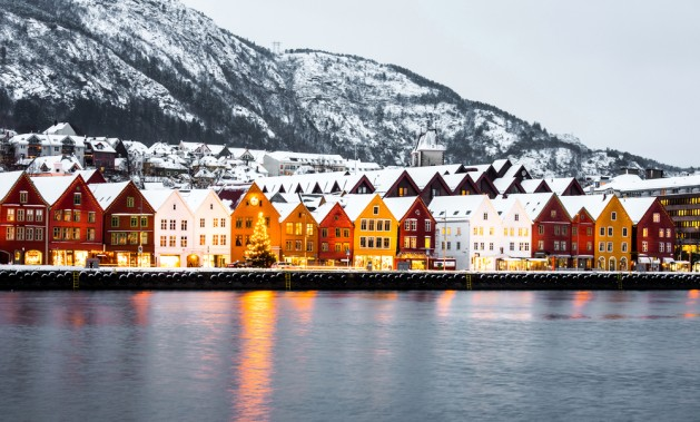 Bryggen street with wooden colored houses in Bergen at Christmas, Norway