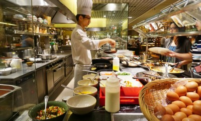 SINGAPORE -10 DEC 2015- Straits Kitchen, a luxury hawker style restaurant located inside the Grand Hyatt hotel, has been singled out by Anthony Bourdain as one of the best restaurants in Singapore.