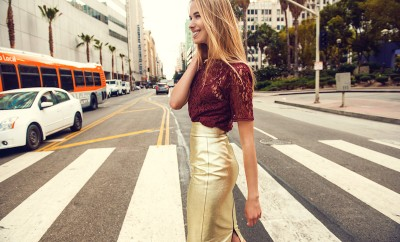 fashionable confident woman walking in city